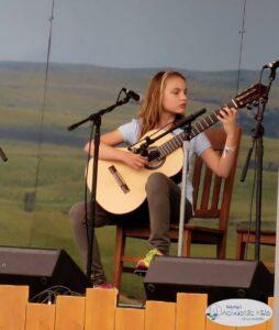 Gwenyth in Acoustic Kids, Walnut Valley Festival, Winfield, KS, ca. 2010