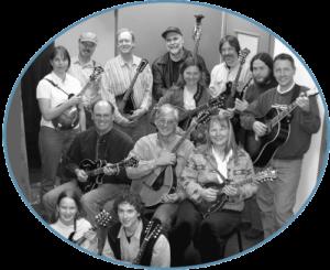 FRONT ROW: Courtney Hartman (2nd mandolin), Martin Wolf (2nd mandolin) MIDDLE: Drew Horton (mandola), Brent Hawley (mandolcello), Susan Dailey (2nd mandolin) BACK ROW: Kelli Trujillo, (2nd mandolin), Dan Mitchell (1st mandolin), Dave Swiss (mandola), Dave Dale (bass), Crystal Kerr (mandola), Ron Lynam (1st mandolin), Grant Gordy (1st mandolin), Tim Gauthier (guitar)